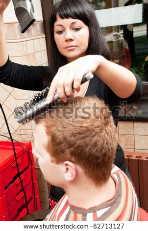 Attractive man in a hairdressing salon - stock photo