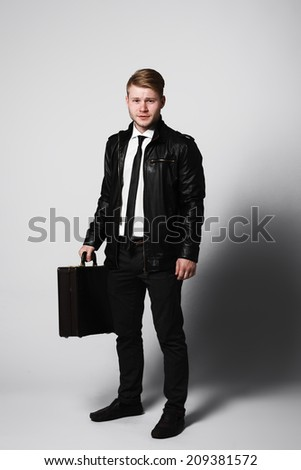 Attractive man in studio  - stock photo