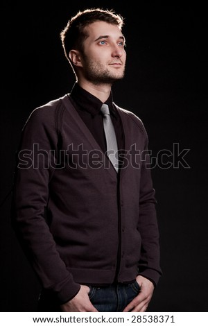 attractive man looking up against black background