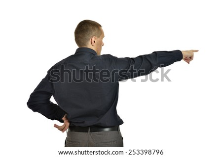 Attractive man pointing on white background - stock photo