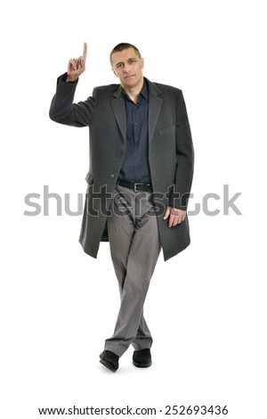 Attractive man pointing up on white background