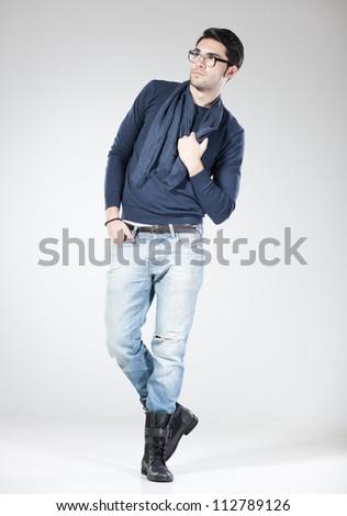 attractive man posing in the studio - full body - stock photo