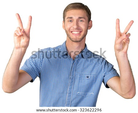 Attractive man shows a sign of peace or victory