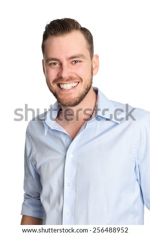 Attractive man standing with a white white background wearing a blue shirt, feeling great!