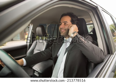 Attractive man talking on the cellphone while driving