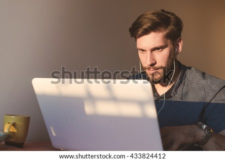 Attractive man using laptop at office