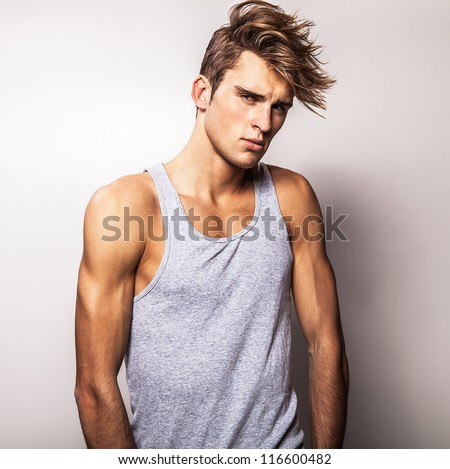 Attractive man wearing T-shirt. - stock photo