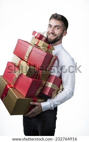 Attractive man with many present boxes