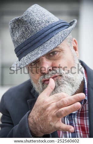 Attractive man 50 years old with beard and hat