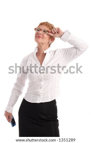 Attractive mature businesswoman with cell phone