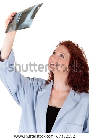 Attractive mature female doctor watching a x-ray. Studio shot. White background