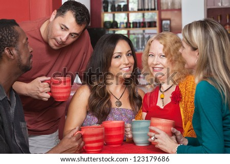 Attractive mature women in diverse group at coffeehouse - stock photo