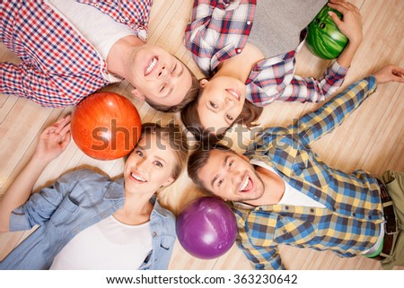 Attractive men and women are playing kegling - stock photo