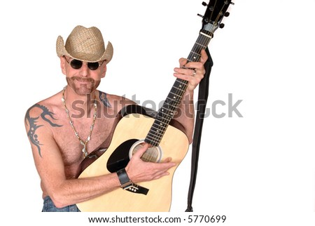Attractive, mid fifties bearded man playing the guitar.  Jeans dressed. Aging beauty, diversity,  music concept. - stock photo