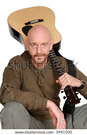 Attractive, mid fifties bearded middle aged man playing the guitar.  Casual dressed. Aging, beauty, music concept. - stock photo
