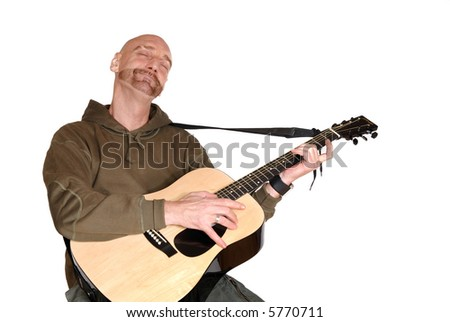 Attractive, mid fifties bearded middle aged man playing the guitar.  Casual dressed. Aging, beauty, music concept.