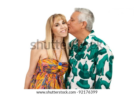 Attractive middle age couple in a affectionate pose with colorful clothes on a white background. - stock photo