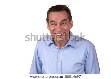 Attractive Middle Age Man in Blue Shirt Laughing with Silly Smile - stock photo