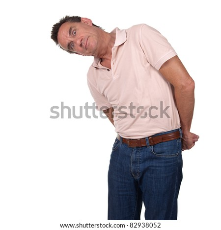 Attractive Middle Age Man Looking Sideways at Something with Surprised Quizzical Look and Hands Behind His Back - stock photo