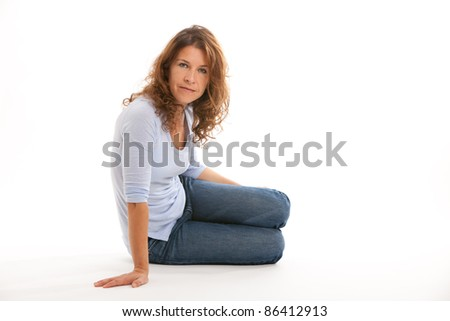 Attractive middle age woman isolated on a white background. - stock photo