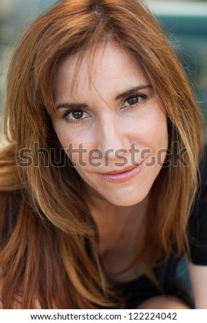 Attractive middle age woman outdoors.