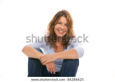Attractive middle age woman with wavy hair on a white background.