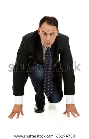 Attractive middle aged caucasian businessman kneeling, ready for race. Studio shot. White background. - stock photo