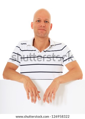 Attractive middle aged man behind blank white placeholder. All on white background. - stock photo