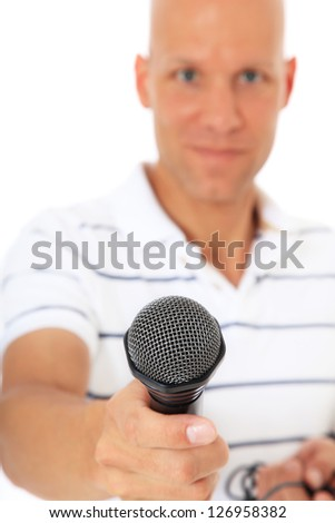 Attractive middle aged man holding microphone. All on white background. - stock photo