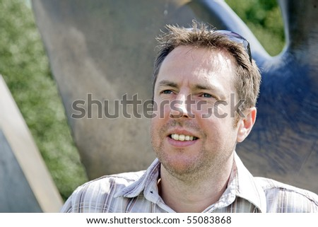 attractive middle-aged man in a park