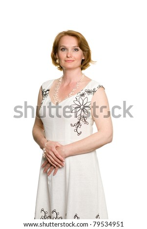 Attractive middle aged woman in a summer dress. - stock photo