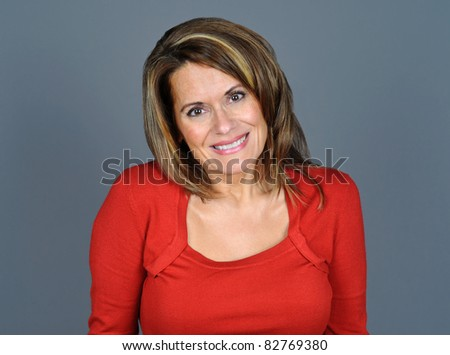 Attractive Middle Aged Woman Wearing a Red Sweater - stock photo
