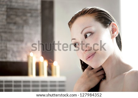 Attractive Mixed Asian Female touching Hair - stock photo
