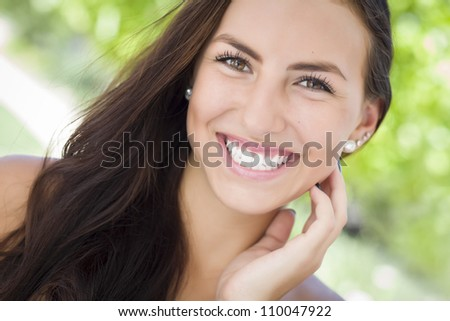 Attractive Mixed Race Girl Portrait Outdoors.