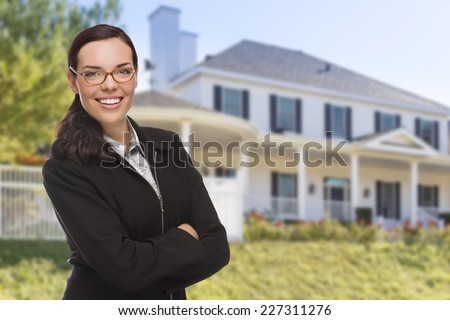Attractive Mixed Race Woman in Front of Beautiful New Custom Built House. - stock photo
