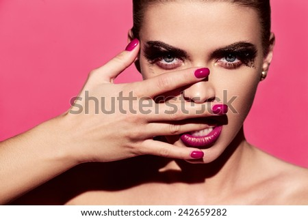 Attractive model with bright make-up and manicure - stock photo