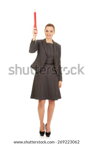 Attractive modern businesswoman pointing up with pencil.  - stock photo