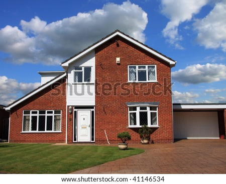 Attractive modern family home with garage blue summer sky - stock photo