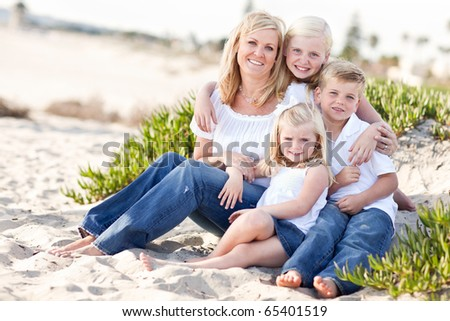 Attractive Mom Portrait with Her Cute Children at The Beach. - stock photo