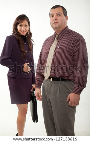 Attractive multi ethnic business man and woman team - stock photo