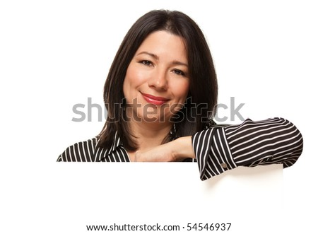 Attractive Multiethnic Woman Resting Arm Behind Blank Sign Corner Isolated on a White Background. - stock photo