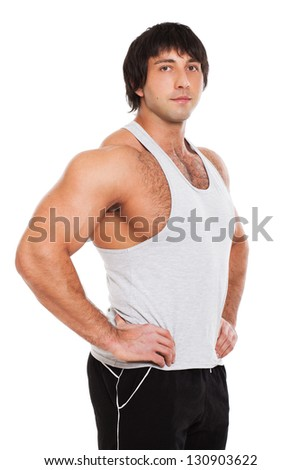 Attractive muscular guy in fitness wear isolated on a white background