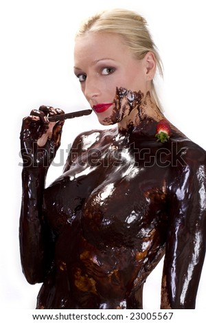 Attractive naked blond girl covered in chocolate eating chocolate with strawberry - stock photo