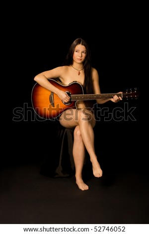 attractive naked girl plays guitar - black background