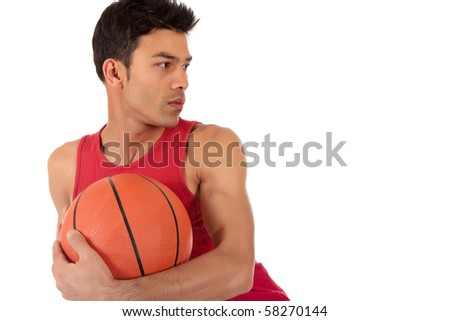 Attractive Nepalese man basketball player holding the ball, looking away. Studio shot. White background.