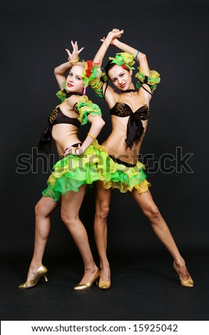 attractive night club dancers over dark background - stock photo