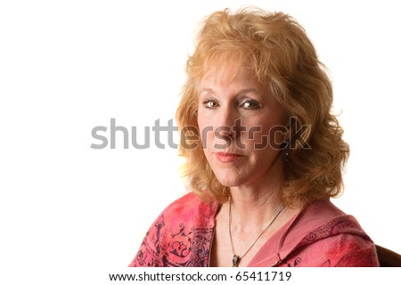 Attractive older blond haired woman isolated over white - stock photo