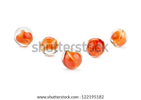 Attractive orange marbles for kids against white background