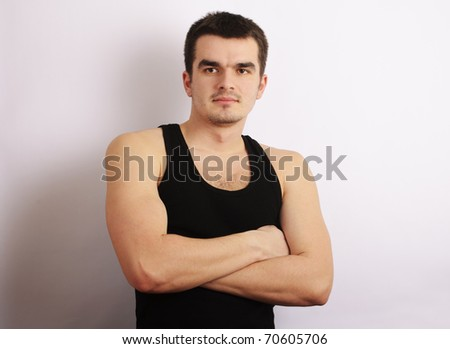 Attractive oung man posing with his arms crossed