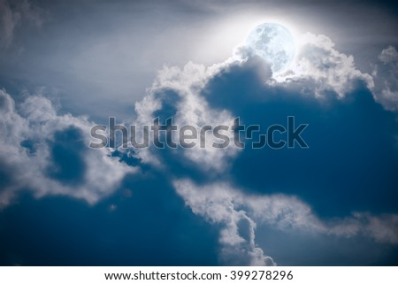 Attractive photo of a nighttime sky with clouds, bright full moon would make a great background. Nightly sky with large moon. - stock photo